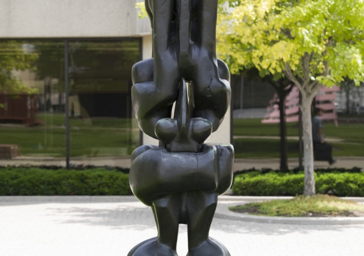 A thin, bronze statue with many forms