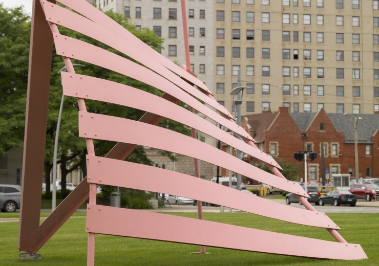 A steel sculpture with curved slats in red enamel