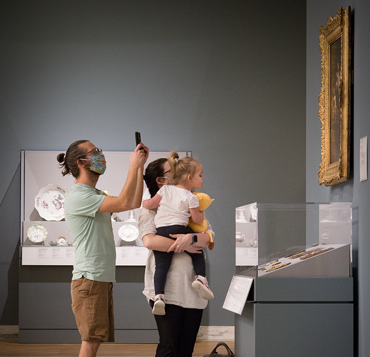 A young family looking at art in the Detroit Institute of Arts